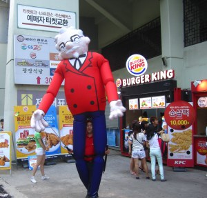 The Colonel encourages Koreans to try his original recipe.