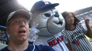 Selfie with the Doosan Bear while photobombing this unsuspecting Korean woman.